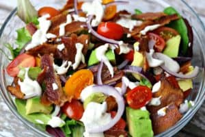 BLT Avocado salad with ranch dressing on top