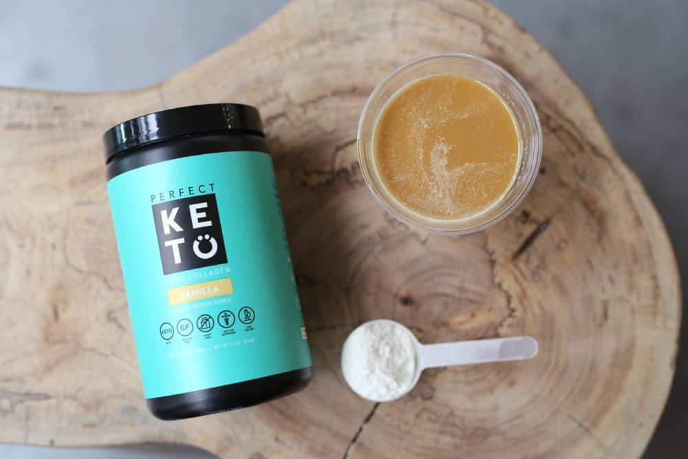 Perfect Keto Collagen with a cup of coffee