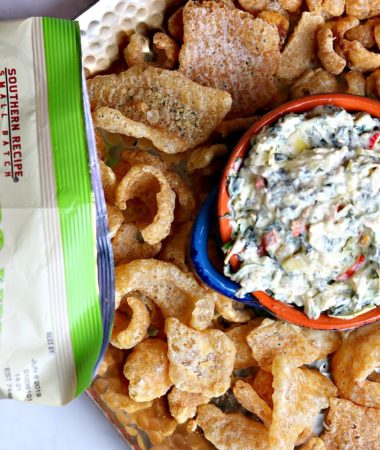 An easy, keto kale recipe for Creamy Kale Artichoke Dip. I served these with Cilantro Lime Pork Rinds, but include other low-carb substitutes for chips. #keto #ketodip #kaledip #ketofood #quick #porkrind
