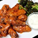 Air Fryer Buffalo Wings on a plate with roasted broccoli and blue cheese dip