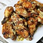Garlic Parmesan Chicken wings on a white plate
