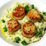 A quick, keto-friendly and grain-free recipe for seared scallops and parmesan cauliflower risotto. #recipe #cauliflower #keto #lowcarb #easydinner #dinnerrecipe #quickmeal