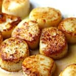 A quick recipe for seared scallops that is done in minutes. This is the perfect protein for a quick keto and low carb meal. #keto #lowcarb #scallops #easydinner #ketodinner #seafood
