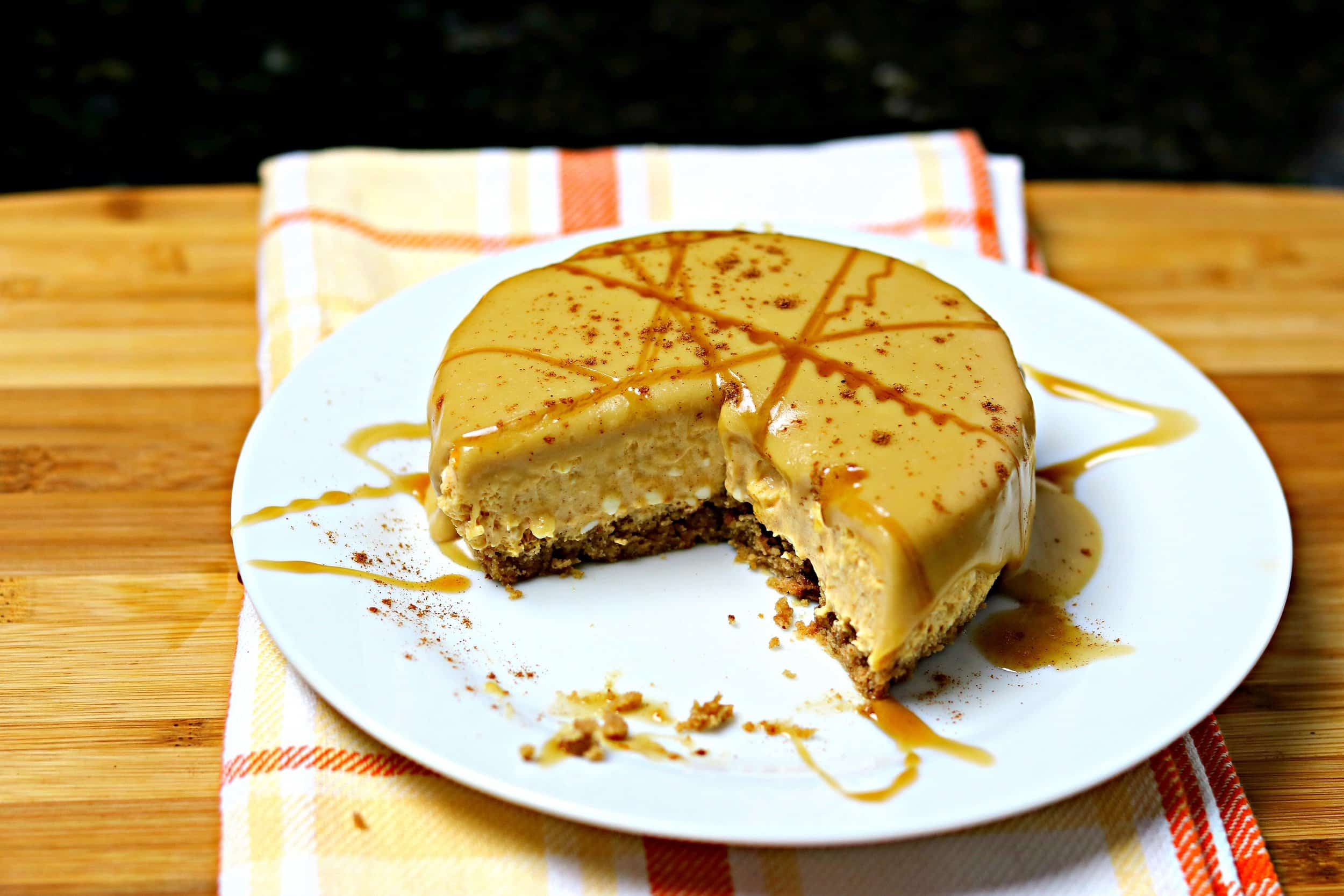 Pumpkin Brandy Cheesecake with Ginger Keto Cookie Crust on a white plate