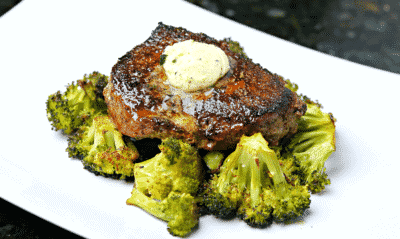 Beef top sirloin steak on a plate with roasted broccoli