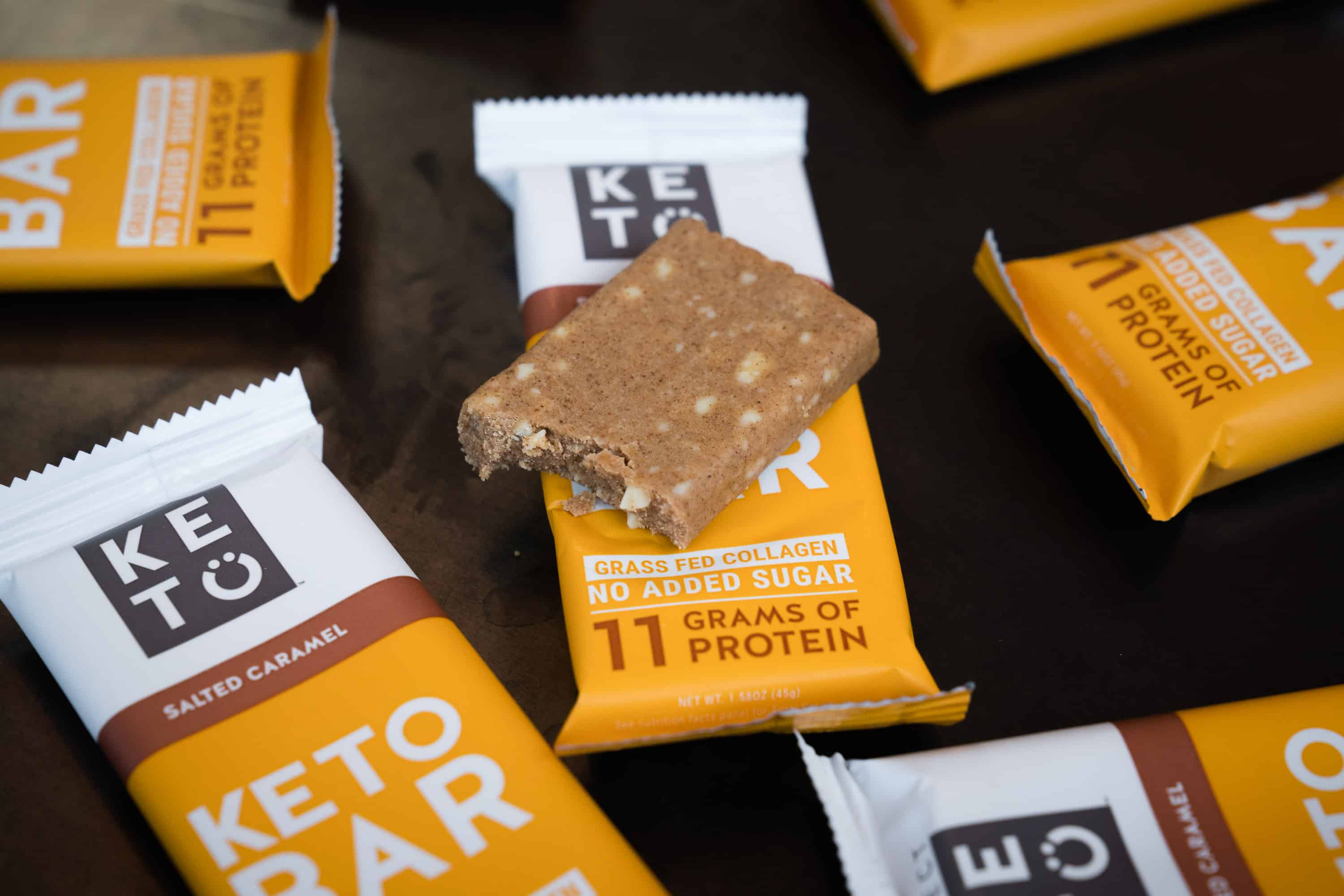 An assortment of Perfect Keto NEW Keto Bars in Lemon Poppyseed & Salted Caramel, with Discount Code