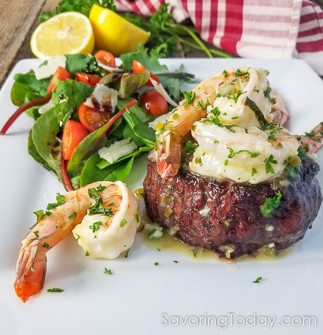 Grilled Steak and Shrimp Scampi for Two, served on a white dish