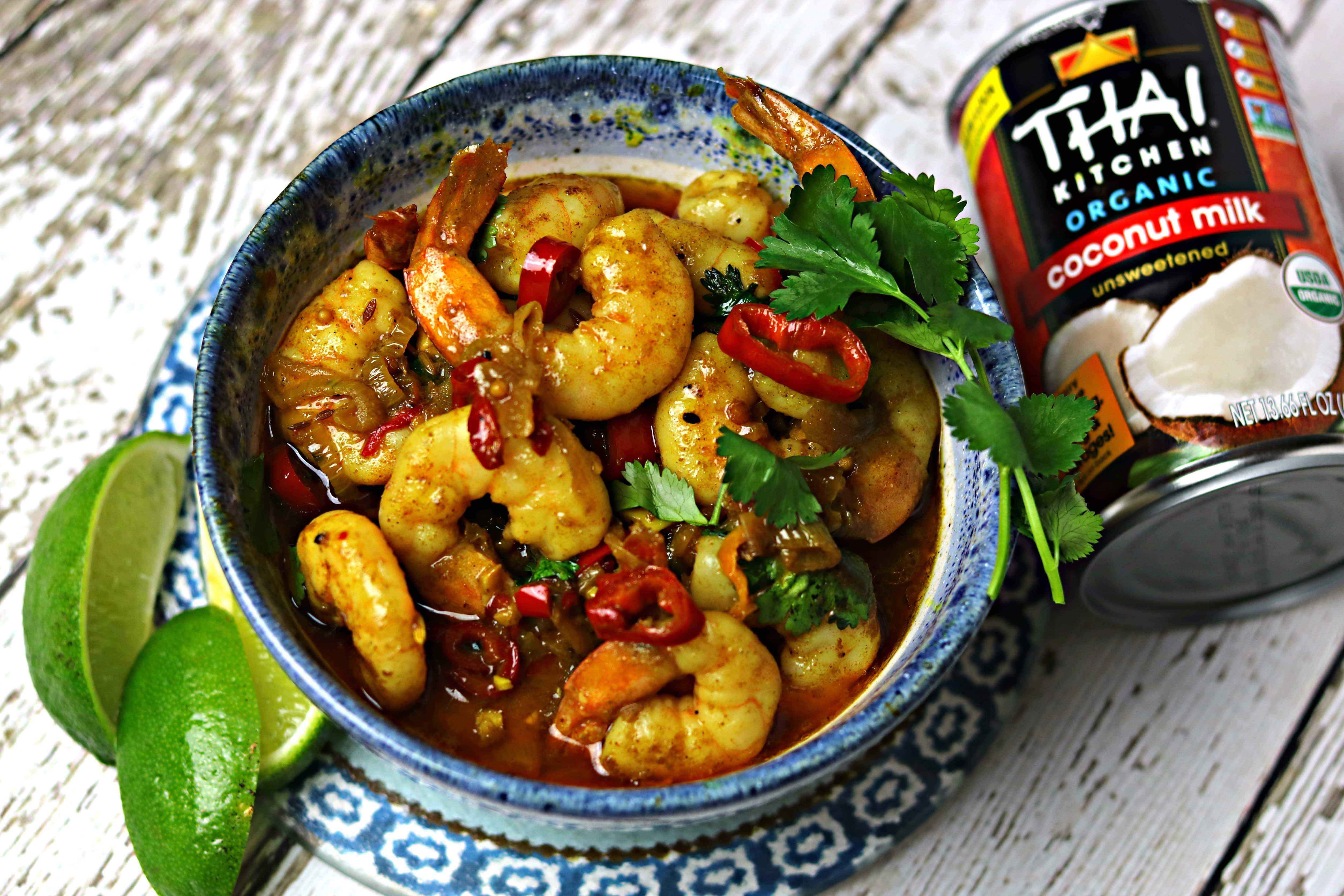 A bowl of Indian Shrimp Curry, next to a can of Thai Kitchen Organic Coconut Milk