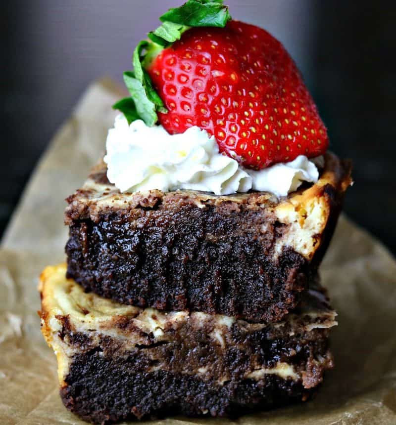 Two cheesecake brownies on a plate