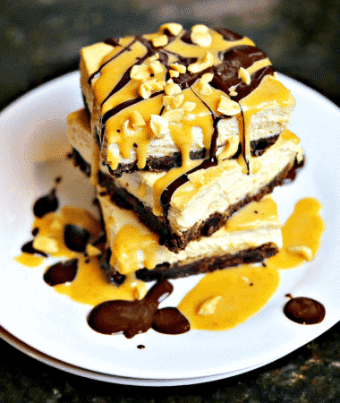 Keto Snickers Cheesecake recipe stacked on a plate