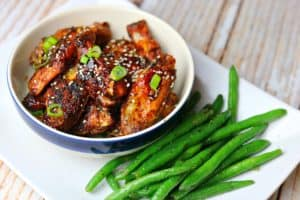 An easy keto recipe that combines crisped chicken wings with a no sugar added, sweet, spicy, and sticky Asian chicken wing sauce. #keto #chickenwings #asianchickenwings #sweetchiliwings #lowcarb #dinner #ketorecipe