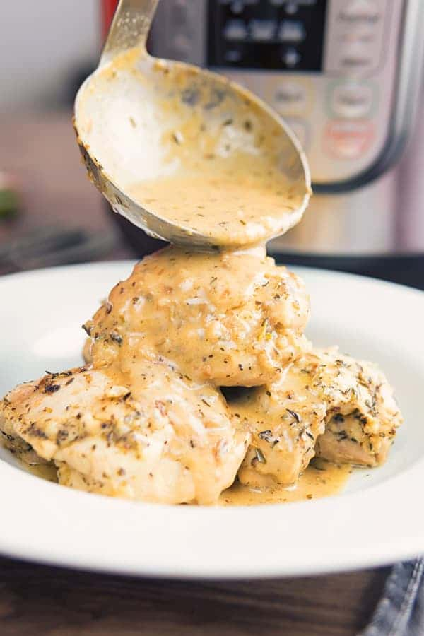 Low Carb Garlic Chicken on a plate with a ladle of sauce