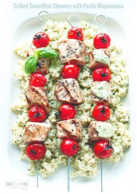 Low Carb Grilled Swordfish Skewers with Pesto Mayo on top of cauliflower rice