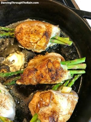 Low Carb Asparagus Stuffed Chicken Breast Recipe in a Cast Iron Skillet