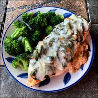 Cheesy Chicken Spinach recipe on a plate with broccoli