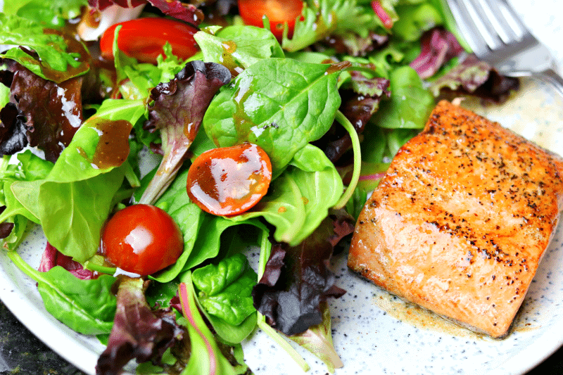 Salad with Low Carb Balsamic Vinaigrette on a plate with salmon