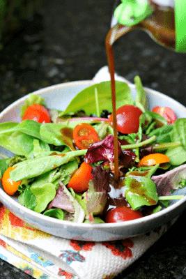 Keto Balsamic Vinaigrette being poured on a salad