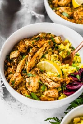 Keto Chicken Shawarma in a white bowl, garnished with lemon and ready to eat.