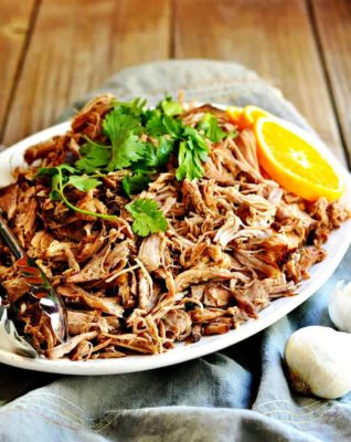 Slow Cooker Pork Carnitas ready to eat on a white plate.