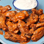 Keto Air Fryer Buffalo wings on a blue plate