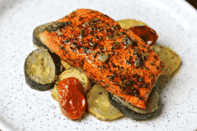Air Fryer salmon on a plate with zucchini