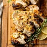 a close up of two sliced chicken breasts on a cutting board