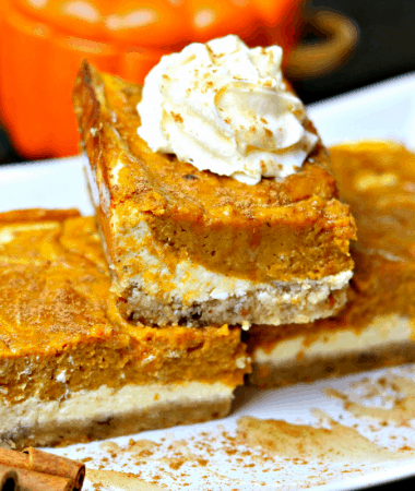 Keto Pumpkin Pie Cheesecake Bars stacked on a plate