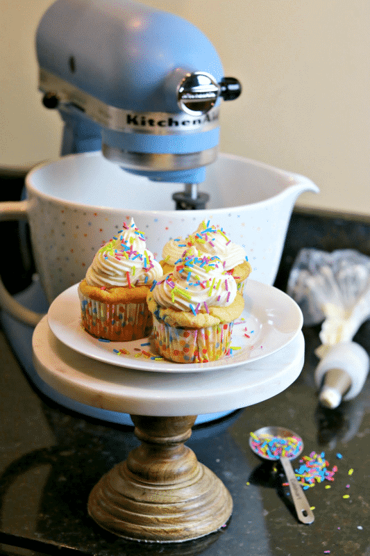 Keto cupcakes on a stand with a KitchenAid stand mixer
