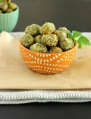 Oven Fried Stuffed Olives stacked in a small orange bowl