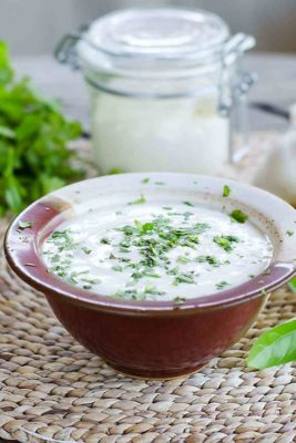 A bowl and jar of Paleo Ranch Dressing