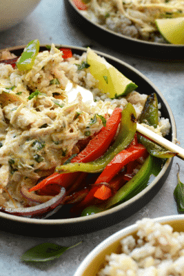 Delicious-looking Coconut Chicken Curry on a plate with sliced peppers and lime