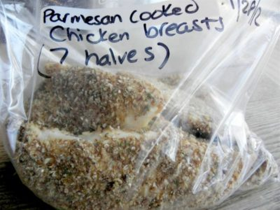Parmesan Covered Chicken Breast pieces in a freezer bag