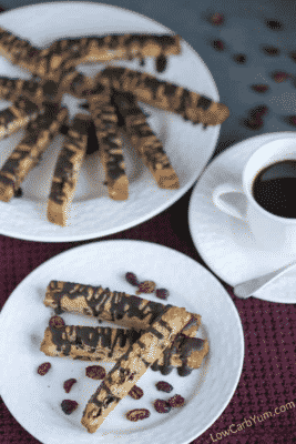 Cranberry Almond Biscotti Cookies on white plates with a cup of coffee