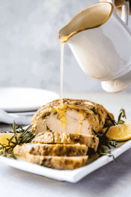 Instant Pot Turkey Breast With Garlic Butter Gravy Being Poured on top
