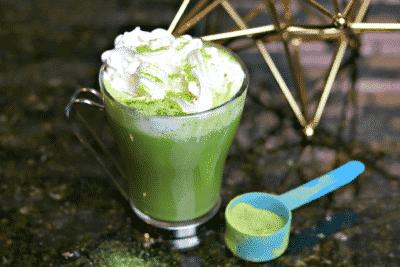 Keto Bulletproof Matcha Latte drink recipe in a glass mug with a scoop of matcha powder