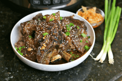Keto Korean BBQ Ribs in a Bowl with green onions & kimchi