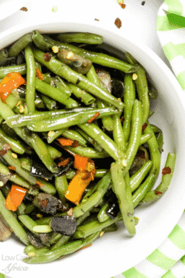 SAUTÉED GREEN BEANS AND MUSHROOMS in a white bowl