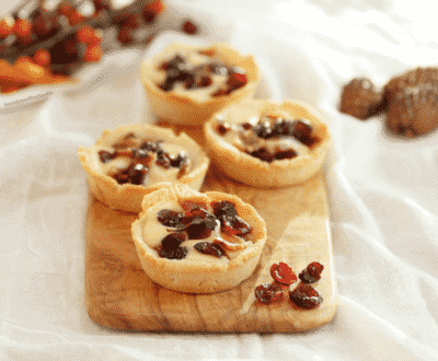 SAVORY BACON CRANBERRY CHEESE TARTLETS on a wooden serving board