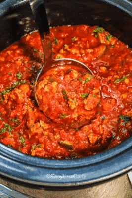 Slow Cooker Healthy Spaghetti Sauce with a laddle