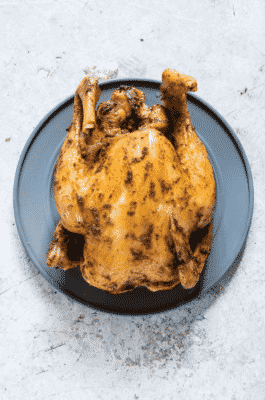 Slow Cooker Whole Chicken on a black serving dish