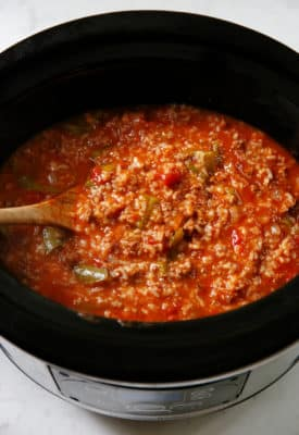 Stuffed Pepper Soup in a cooking pot with a wooden spoon