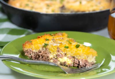 Low Carb Cheeseburger Pie on a green plate