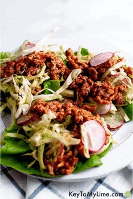 Ground Turkey Lettuce Wraps with Creamy Cilantro Slaw on a white serving dish