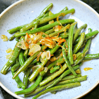 Sauteed Green Beans on a plate with shallots and garlic