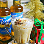 Keto Chai Tea Latte Drink recipe on a coaster with cinnamon sticks