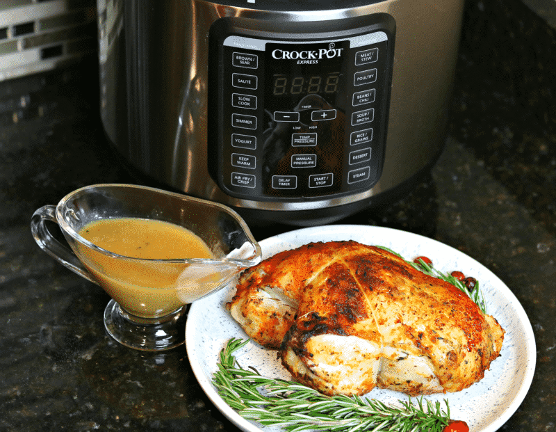 Unsliced Turkey Breast with gravy in front of Crock-Pot Express
