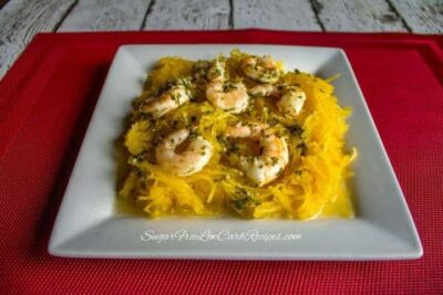 Crock Pot Shrimp Scampi served on a bed of spaghetti squash.