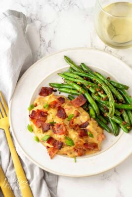 Bacon Ranch Chicken on a white plate with green beans.