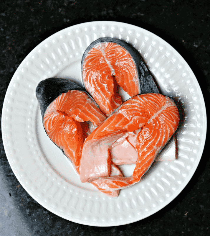 Salmon Steaks with the bones removed on a plate