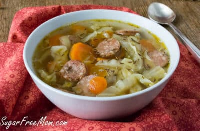 Large white bowl of Keto Cabbage Soup with Sausage, ready to eat.